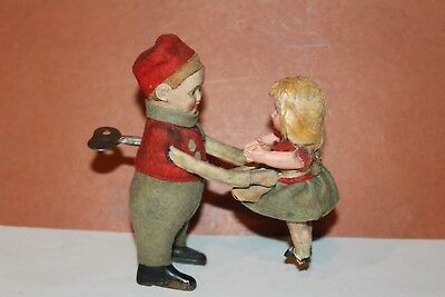 Vintage Schuco Wind Up Twirling Boy With Young Girl