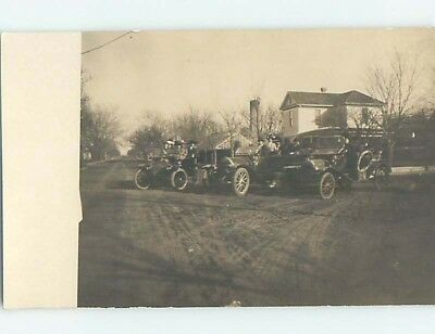 Pre-1918 rppc THREE VERY OLD AUTOMOBILE CARS PARKED TOGETHER ON STREET HL9918