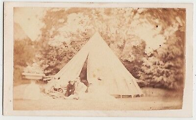 Camping CDV-Man sitting outside his tent with his dog