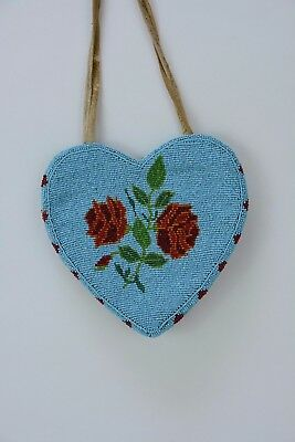 Early to Mid 20th Century Yakima Indian Beaded Heart Shaped Bag on hide