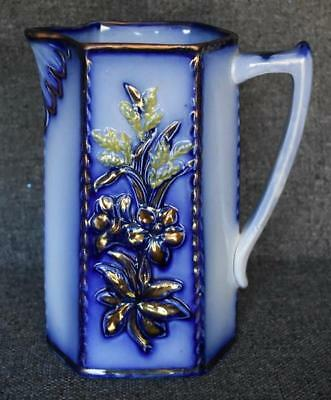 Antique Flow Blue Floral Motif Pitcher With Copper Lustre And Yellow Highlights