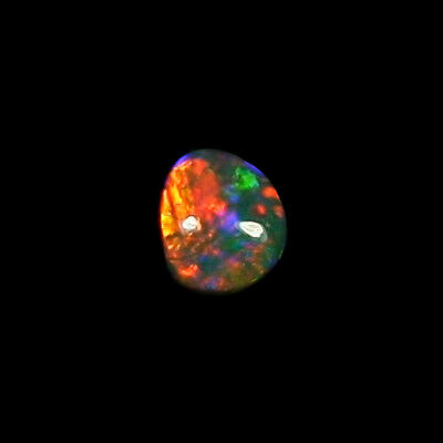 1,09 ct Black Crystal Opal 8,99 x 7,86 x 3,00 mm