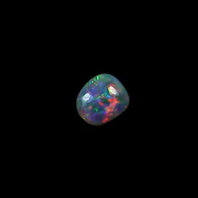 0,84 ct Black Crystal Opal 7,30 x 6,45 x 3,09 mm