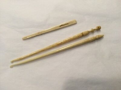 Two antique carved  bone crochet hooks and a carved bone bodkin