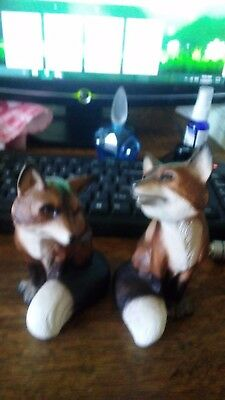 two(2) ceramic red foxes, made in japan
