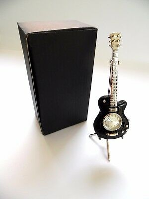 NOVELTY GUITAR CLOCK- BLACK GUITAR with STRINGS on a SHINY SILVER STAND in a BOX