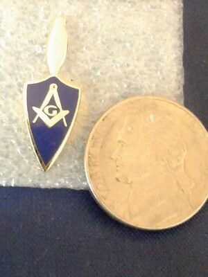 Masonic lapel pin (Trowel) with square and compass with letter (G)
