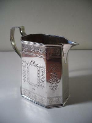 An Antique Silver Jug With Ornate Decoration : London 1879