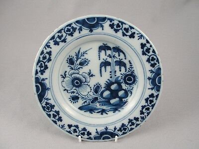 English blue and white delft / tin glaze plate with tree, floral and rocks 2