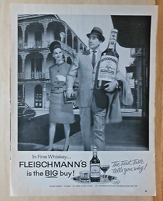 1963 magazine ad for Fleischmann's Whiskey - man with big bottle in New Orleans