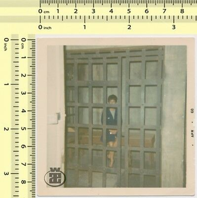 024 1960s Abstract Portrait Woman in Prison Cell, Metal Doors, vintage photo