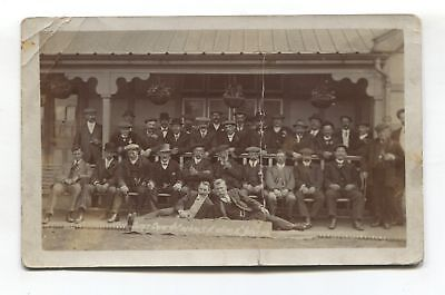 Work's outing - group portrait, firm's name unclear - old real photo postcard
