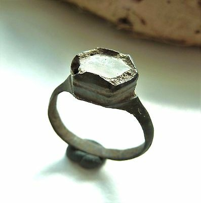 Old bronze ring with glass insert (396).