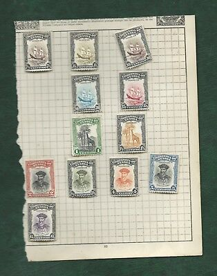 Portugal Colonies Nyassa 12 old mounted mint stamps MH on album page
