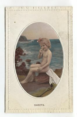 Cute little girl by the sea shore - old postcard