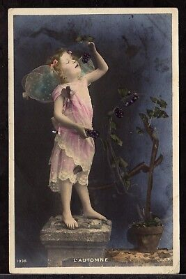 Postcard ~ LITTLE GIRL FAIRY Eating GRAPES Hand Coloured L'AUTOMNE ~ 1905