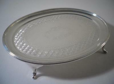 A Georgian Style Silver Teapot Stand With Engraved Decoration: London 1931
