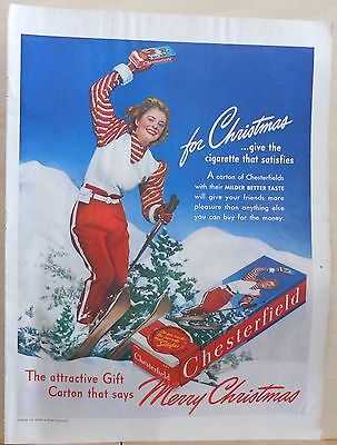 1940  magazine ad for Chesterfield Cigarettes - Skiing woman waves gift carton