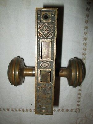 Antique metal Brass? very ornate set of two door knobs and hardware