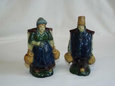 Antique pair of Belgium Pottery water carrier figurines.