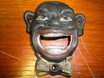 Black Face cast iron bottle opener or paper weight new antique finish wall mount