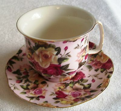 China Cup And Saucer With Assorted  Multicolored Small Roses On Pink Backround.