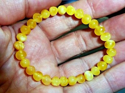 Natural Egg Yolk Baltic amber beaded bracelet made from round polished beads.