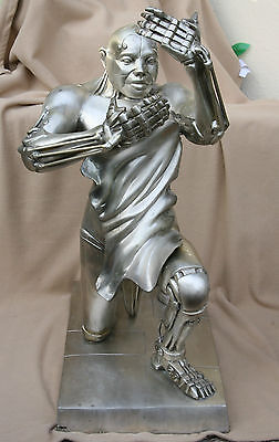 Curiosa erotic metal sculpture of a ithyphallic android robot lover