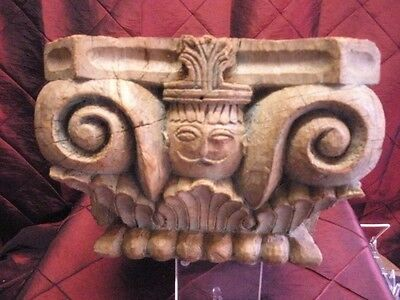 Antique hand carved hard wood column capital with a deity