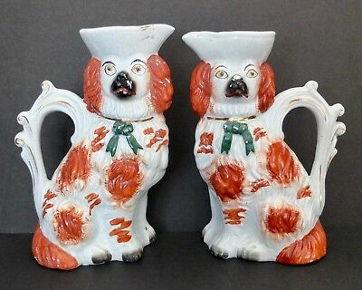 Pair Of Antique Staffordshire Spaniel Dog Pitchers In Russet Red With Gold