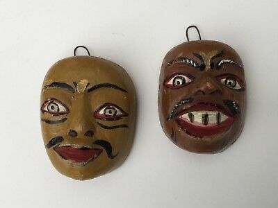 Pair of mid 20th C. Small Old Hand Carved and Painted Indian Head Wall Plaques