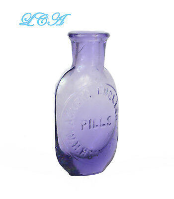 Tiny oval ACKER'S ENGLISH PILLs flask PURE PURPLE antique bottle W.H. HOOKER Co
