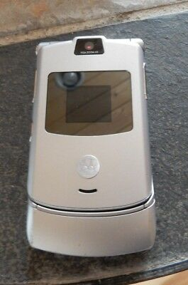 Motorola Model V3 GSM  RAZR used does not charge with charger Manual  PARTS ?!?