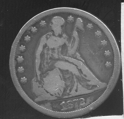1872 Seated Liberty silver dollar. Grades VG or so, was cleaned long ago.
