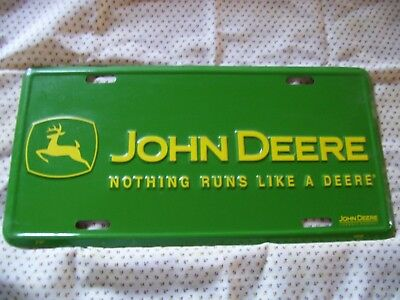 """License plate features 2000 John Deere logo in green and yellow. 12"""" x 6"""""""
