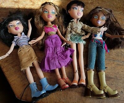 Bratz dolls job lot of 4 dressed in Bratz clothes official toys role play kids
