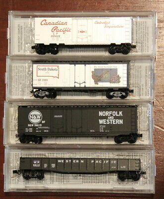 Micro Trains 3 Box cars and 1 open