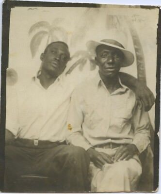 Black/african-American Photo Booth Portrait.  Affectionate Son W/. Father?.