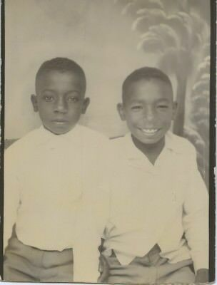 Black/african-American Photo Booth Portrait.  Smiling & Stone Faced Boys.