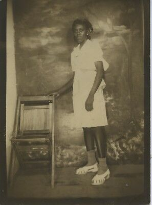 Black/african-American Arcade Portrait.  Somber Young Woman.