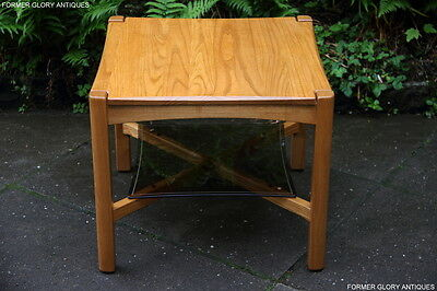 An Ercol Light Elm Wine Tea Coffee Table Side End Armchair Lamp Phone Book Stand