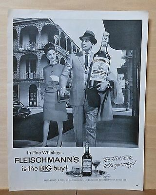 1963 magazine ad for Fleischmann's Whiskey -man w/ big bottle visits New Orleans