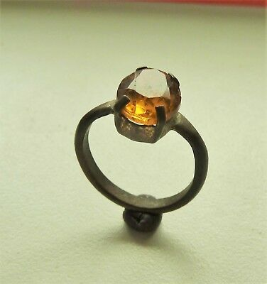 Old bronze ring with yellow glass insert (251).
