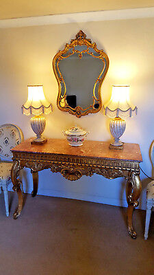 Very ornate gilt marble top console table