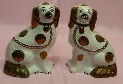 Matched pair of gold antique Staffordshire dogs