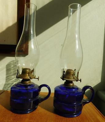 AUC4 A fine pair of Antique Cobalt Blue Glass Font Table Finger Lamps 1900s