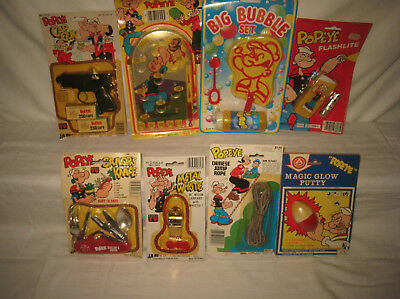 Lot of Eight Assorted Vintage Popeye Toys, Games, Etc All Mint On Cards MQ10