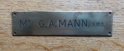 An old BRASS NAMEPLATE inscribed with Mr G A MANN, S.M.O.