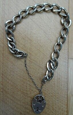 CHARM BRASLET with silver heart lock