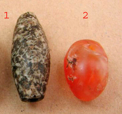 Two neolithic beads one of Diorite the other of Agate